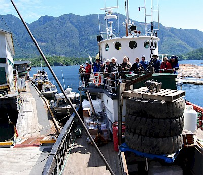 Passengers watch from the safety of the upper deck as the Mv Uchuck III crew deftly offload freight to a remote salmon fishing lodge in Nootka Sound.