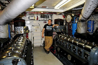 Chief Engineer Frank Crowther in the engine room of the MV Uchuck III.
